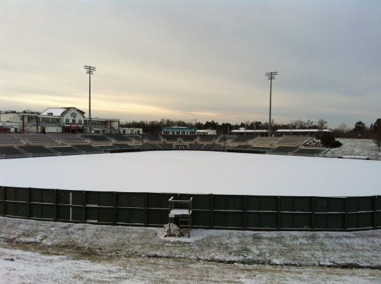 The view from beyond the centerfield wall at CMC-NorthEast Stadium after yesterday's snowfall.